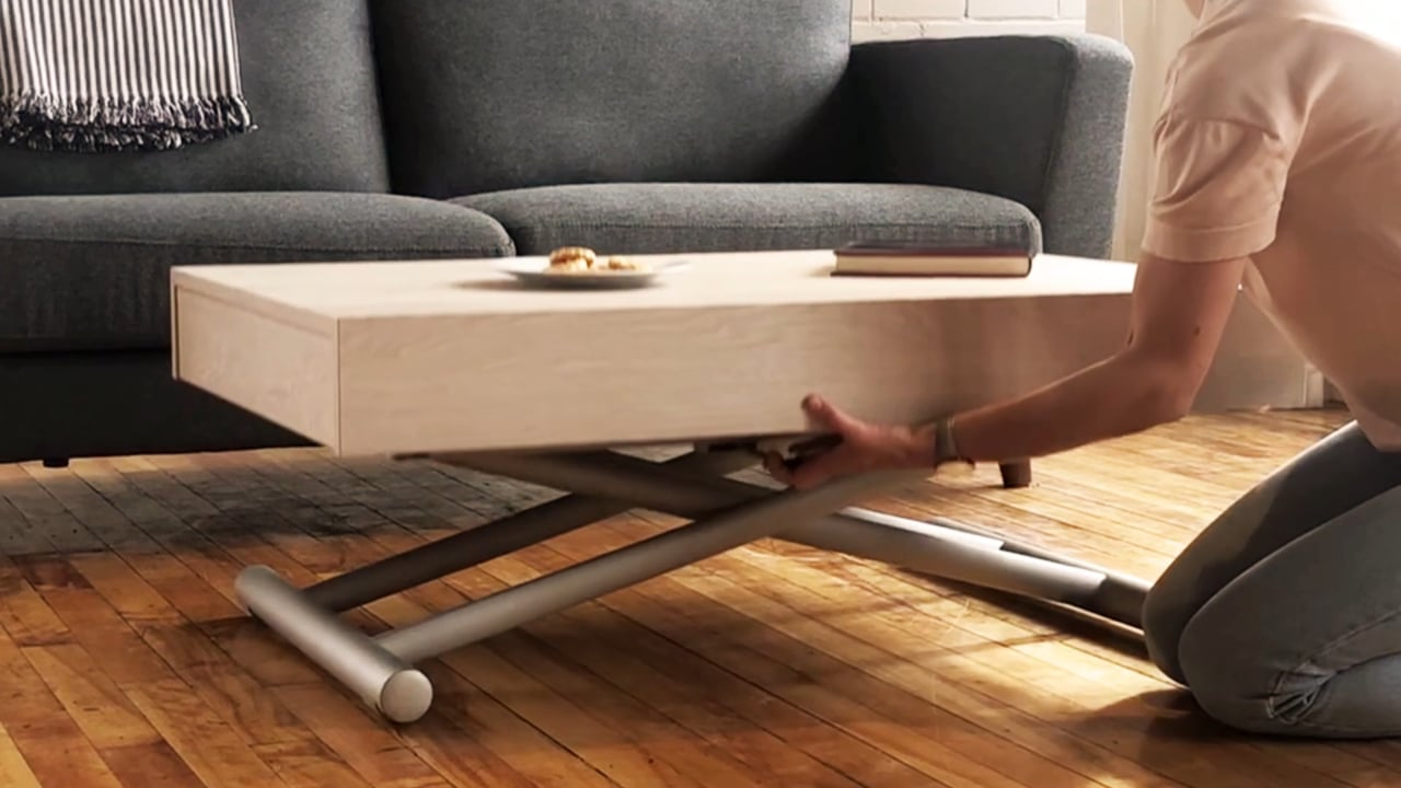 Coffee table in living room with lift mechanisms