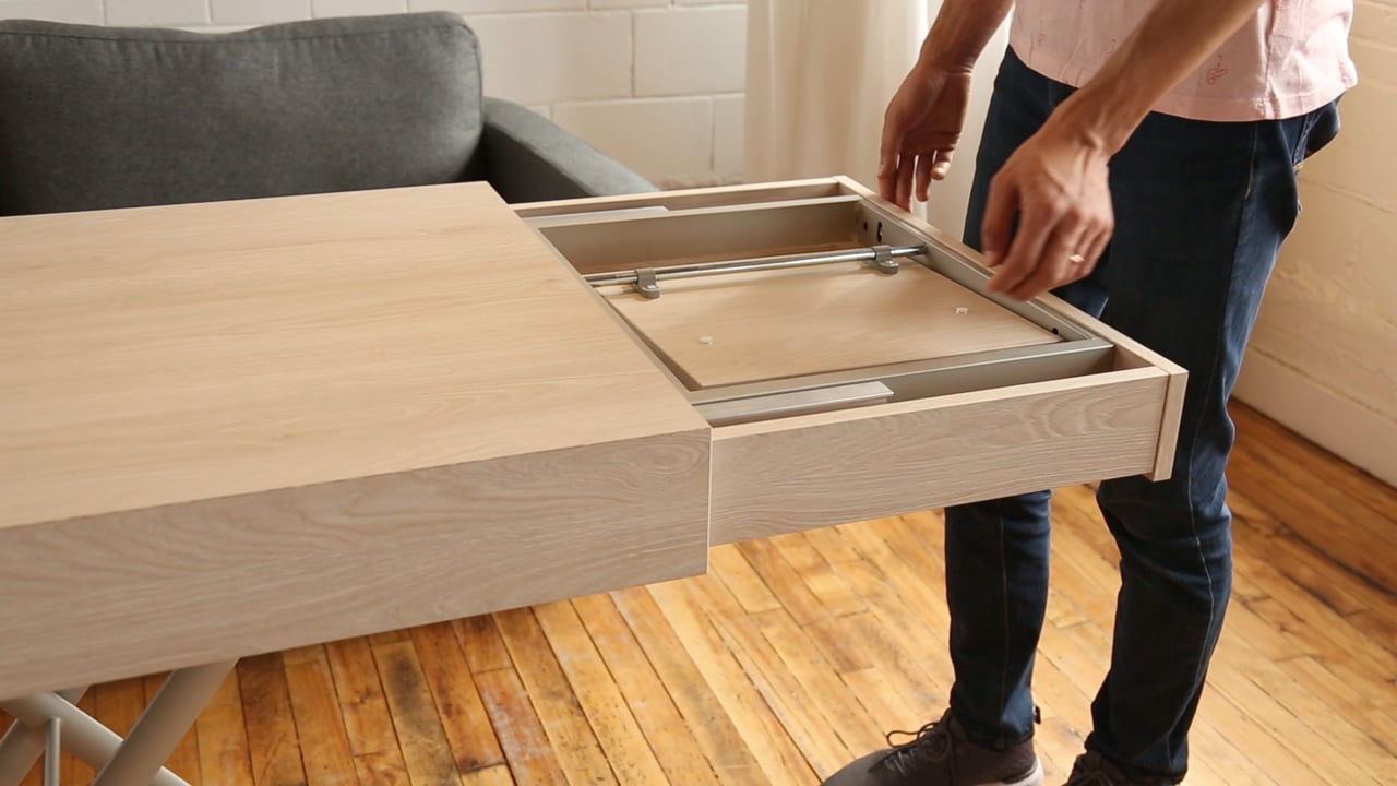 Man extending table with included extensions