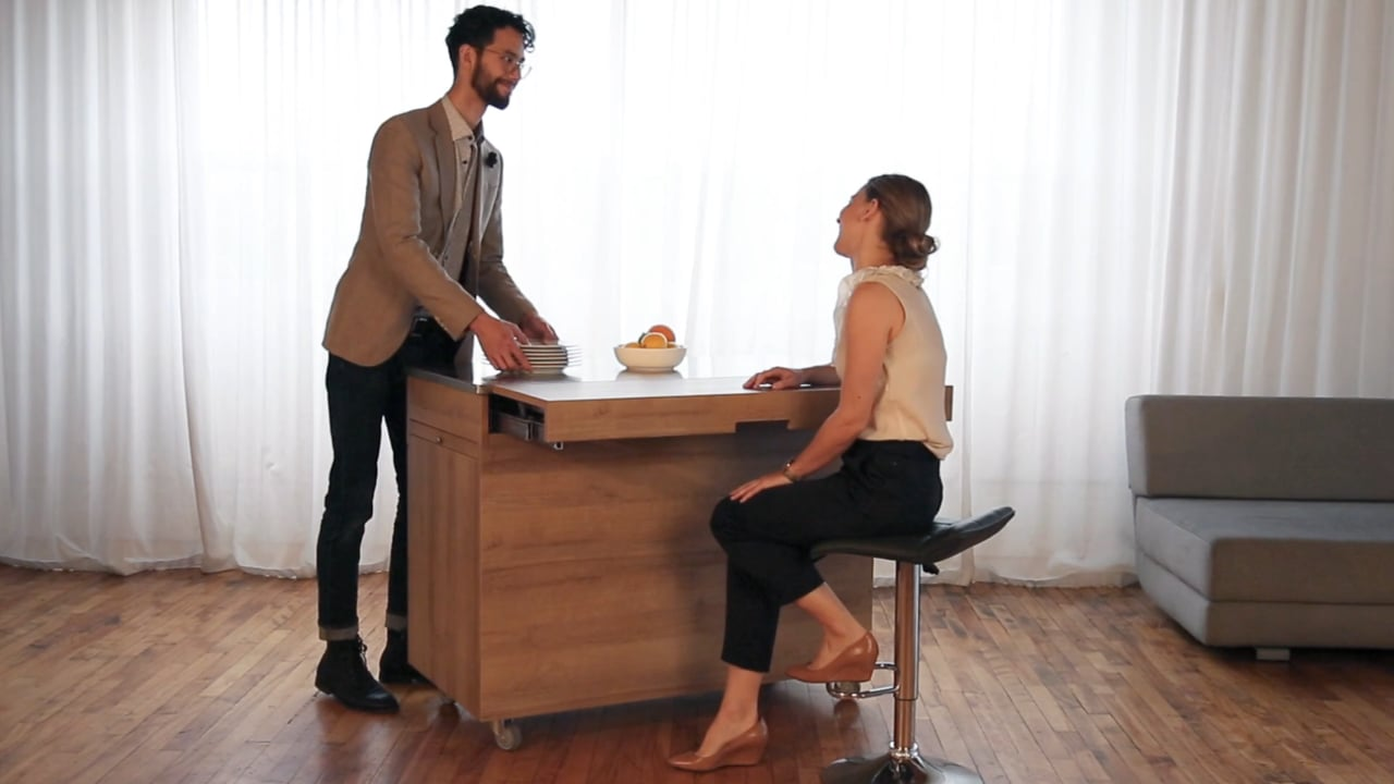 Man and woman sitting and chatting around a bar